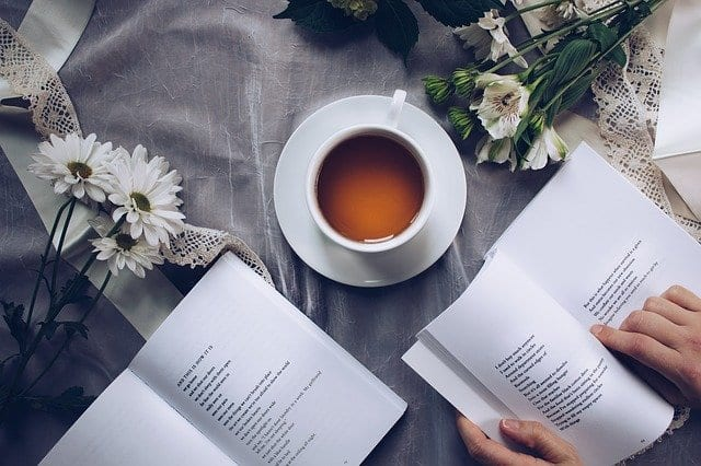 tea cups, flowers, and poetry books
